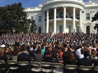 President Obama takes the stage to speak to hundreds of Olympic athletes on the South Lawn of the White House. (Photo by Chris Leyden)